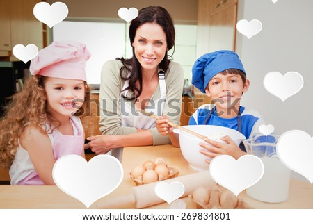 Mother and her children preparing cake against cute hearts - stock photo