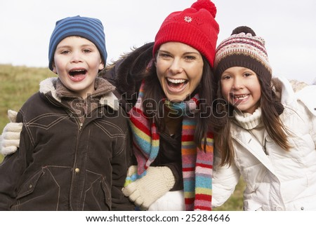 Mother And Her Children Smiling