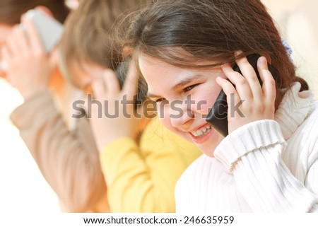 Mother and her children talking on mobile smartphone - stock photo