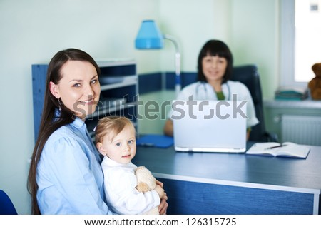 Mother and her daughter at the pediatrician - stock photo
