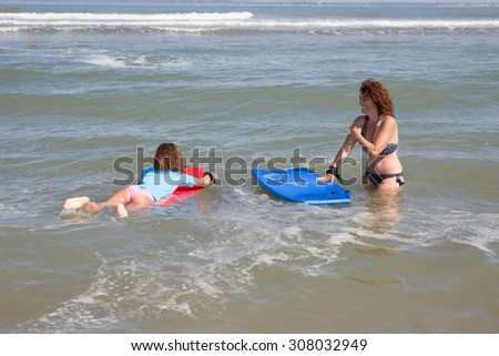 Mother and her daughter at the sea