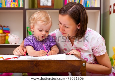 mother and her daughter, drawing with pencils - stock photo