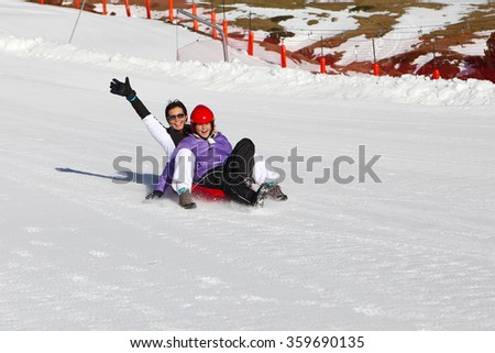 Mother and her daughter enjoying sleigh ride.Outdoor winter fun for family Christmas vacation - stock photo