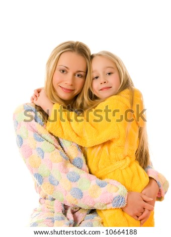 Mother and her daughter in colorful bathrobes - stock photo