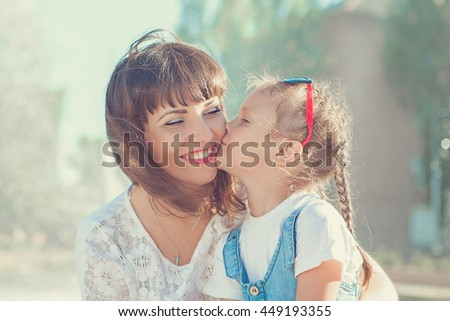 Mother and her daughter laughing and having fun outdoor. Happy family. Positive human emotions, feelings, joy. Near fountain - stock photo