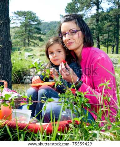 Mother and her daughter on a picnic - stock photo