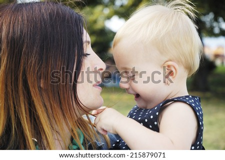 mother and her daughter on outdoor - stock photo