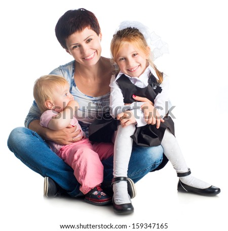 mother and her daughters isolated on white background - stock photo