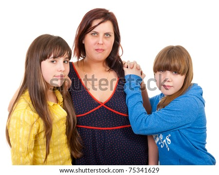 Mother and her daughters portrait isolated on white background - stock photo
