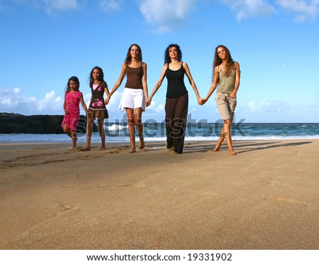 Mother and Her Daughters Walking Along the Beach