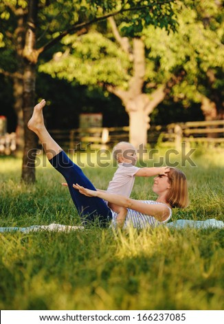 Mother and her daugther practice yoga - stock photo