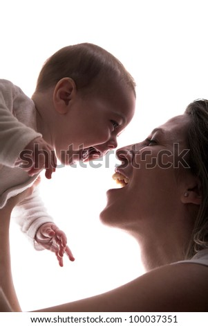 Mother and her happy little baby boy laugh together - stock photo