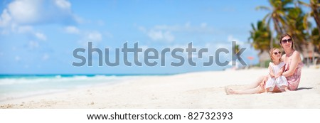 Mother and her little daughter enjoying Caribbean beach vacation - stock photo