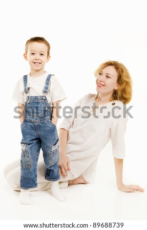 Mother and her little son play together - stock photo