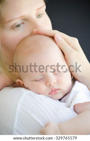 Mother and her Newborn Baby - stock photo