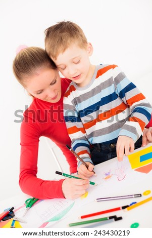 Mother and her son drawing nice picture