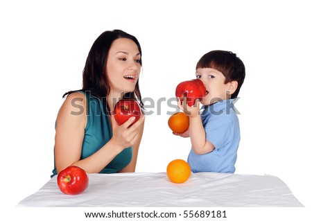 mother and her son eating apples - stock photo