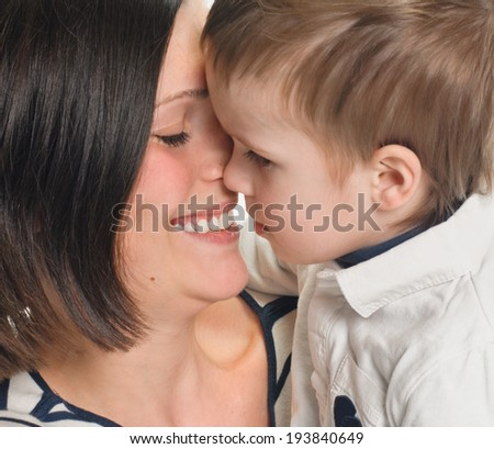 Mother and her son embracing close up