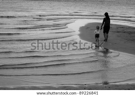 Mother and her son on Chaweng beach,Samui Thailand