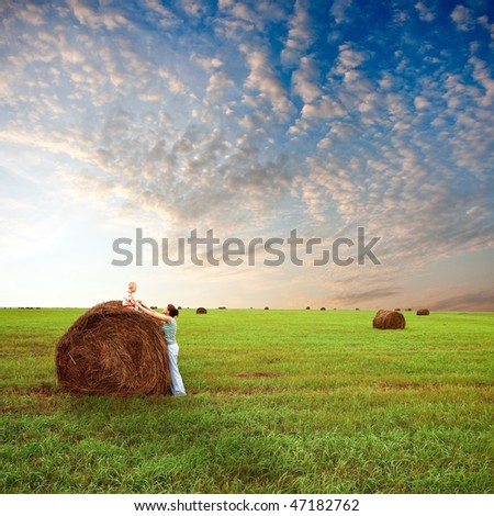 mother and her son on filed - stock photo