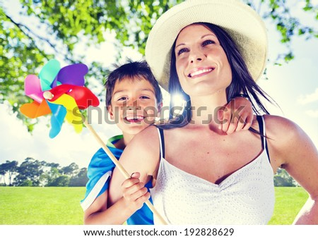 Mother and her son together outdoors. - stock photo
