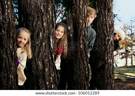 Mother and her three kids - stock photo