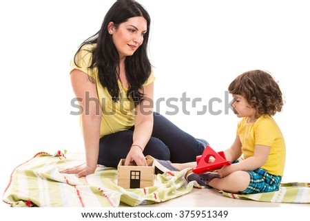 Mother and her toddler son having conversation home - stock photo