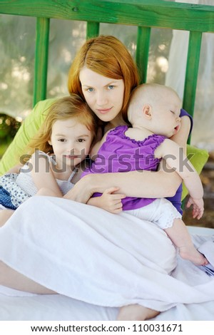 Mother and her two daughters outdoors - stock photo