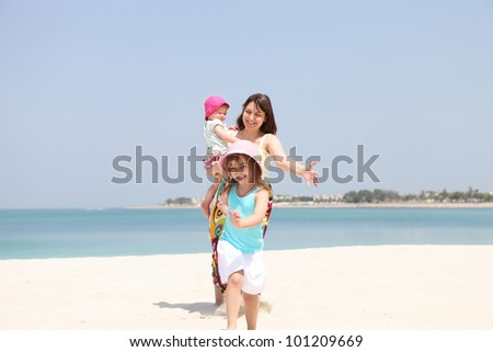 Mother and her two little daughters enjoying vacation - stock photo