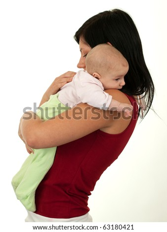mother and her two month old son are together mom hugging baby in her arms