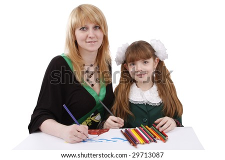Mother and her young daughter drawing together, set of felt tips on the table.Girl is painting her family in bright colours.  Isolated over white background. - stock photo
