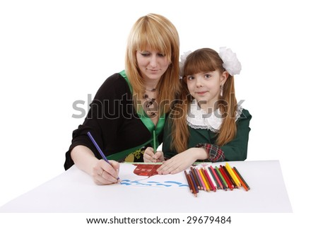 Mother and her young daughter drawing together, set of felt tips on the table. Schoolgirl is  drawing  in pencil. Woman is painting the picture. Isolated over white background. - stock photo
