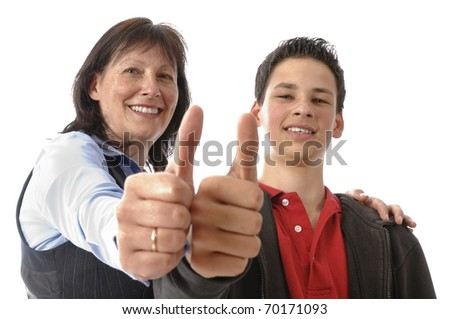"Mother and her young son stand next to each other, is proud and hugged the boy in front of white background. Doing the ""thumbs up"" gesture. - stock photo"