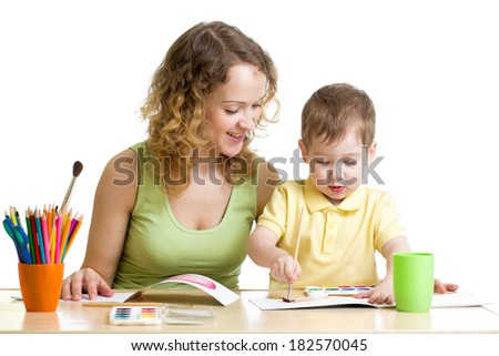 mother and kid boy paint together - stock photo
