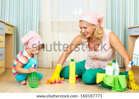 mother and kid cleaning room - stock photo
