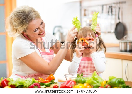 mother and kid cooking and having fun in kitchen - stock photo