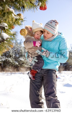 Mother and kid decorating Christmas tree - stock photo