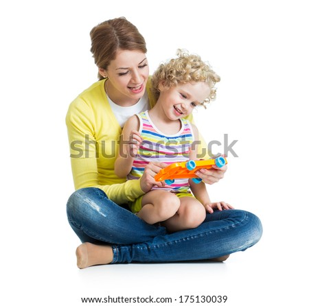 Mother and kid girl having fun with musical toy. Isolated on white background - stock photo
