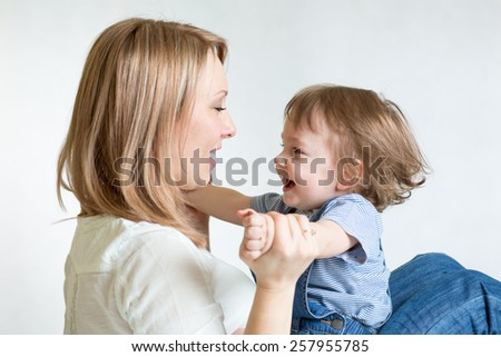 Mother and kid having fun pastime. Parenthood happiness conception. - stock photo