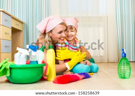 mother and kid ready to room cleaning - stock photo