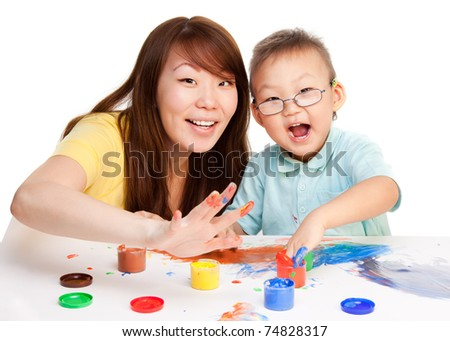 Mother and kid spending some time together painting with their hands - stock photo