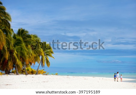 Mother and kids family at tropical beach on Aitutaki island, Cook Islands, South Pacific - stock photo