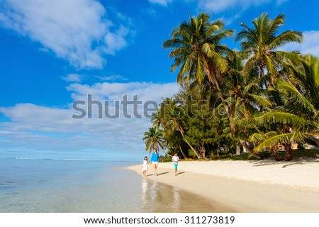 Mother and kids family at tropical beach on Rarotonga island, Cook Islands, South Pacific - stock photo