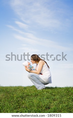 Mother and little baby. Sky. Grass. 2 - stock photo