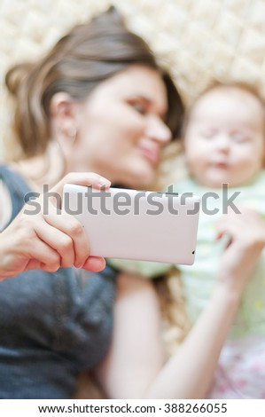 mother and little baby taking selfie