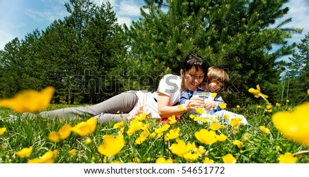 Mother and little boy enjoy on sunny day - stock photo