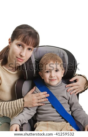 Mother and little child on vehicle car safety seat - stock photo