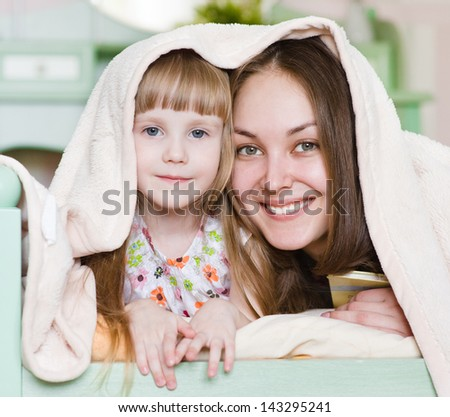 Mother and little girl having time together - stock photo
