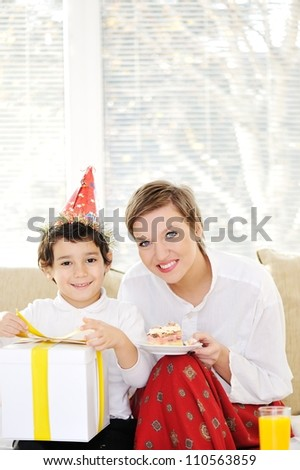Mother and little son at home - stock photo