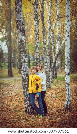 Mother and little son in park or forest, outdoors.  - stock photo